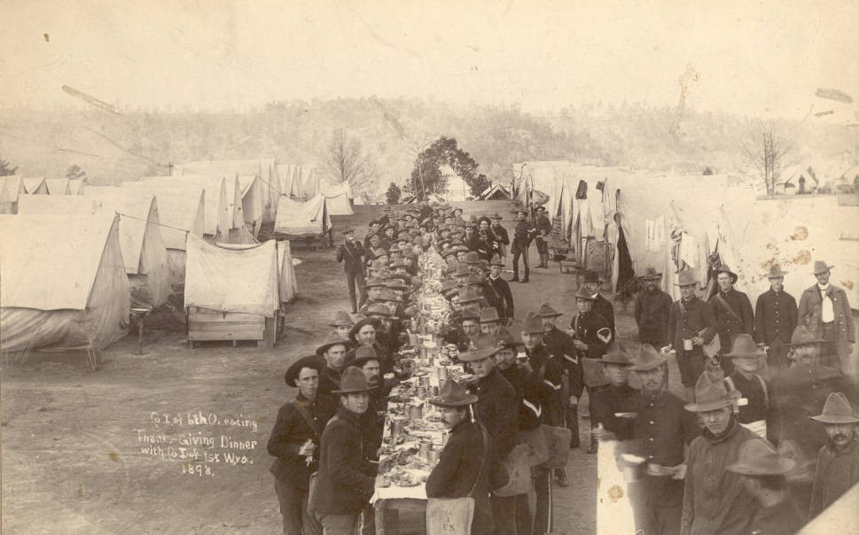 Company I of the 6th OVI eating Thanksgiving dinner with the 1st West Virginia Volunteer Infantry Company I at Camp Poland in Knoxville, Tennessee,1898. Courtesy of the Rutherford B. Hayes Presidential Center via Ohio Memory.