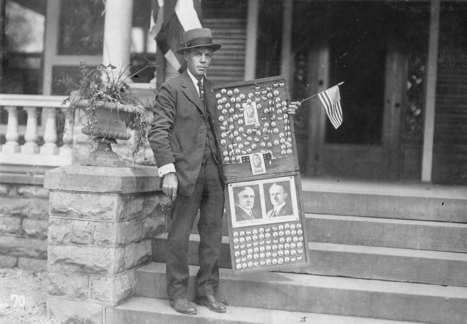 Harding supporter selling buttons for the 1920 campaign, via Ohio Memory.