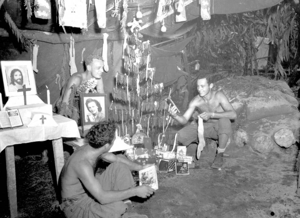 37th Infantry Division soldiers celebrating Christmas, probably at Bougainville, Solomon Islands, December, 1943. Via Ohio Memory