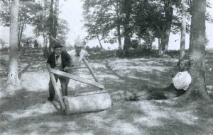 Jay Cooke III and Edward Lewis rolling the lawn on Gibraltar Island in preparation to play tennis, via Ohio Memory