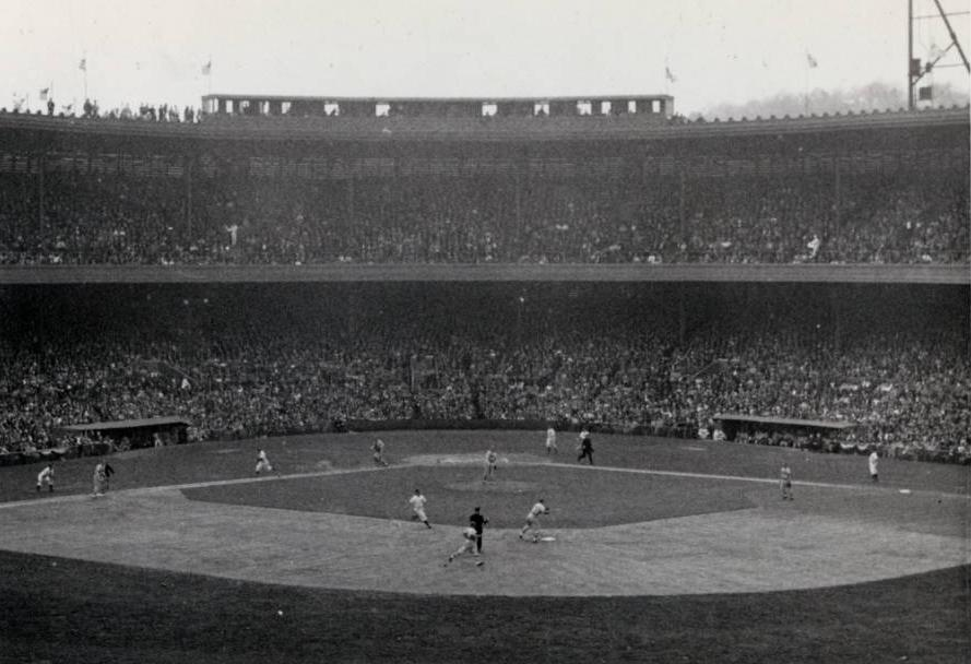 Packed stadium watching a baseball game, via the Ohio Guide Collection on Ohio Memory.