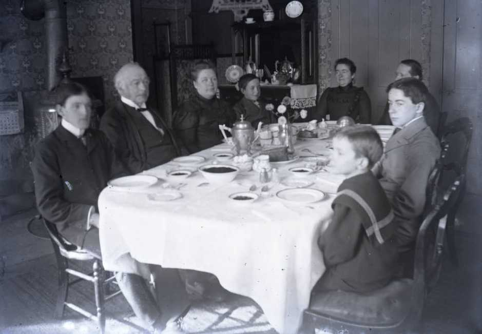 Group seated at the dinner table, via Ohio Memory.