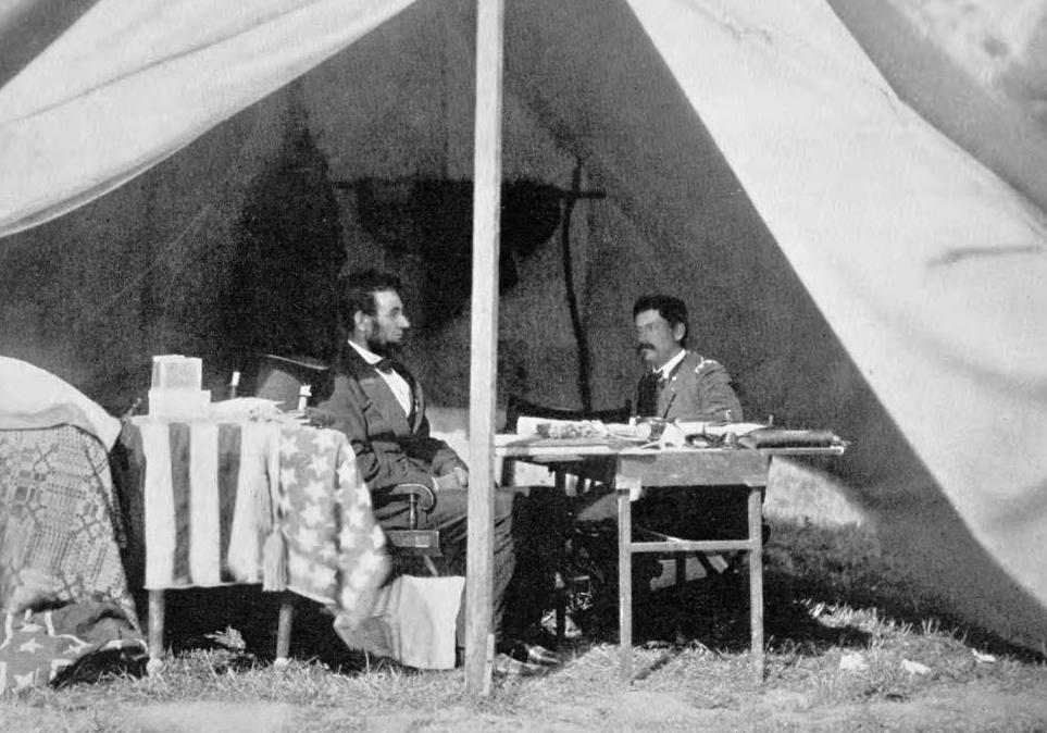 President Abraham Lincoln and General George McClellan photographed by Mathew Brady on October 3, 1862, after the Battle of Antietam and the announcement of the Emancipation Proclamation. Via Ohio Memory.