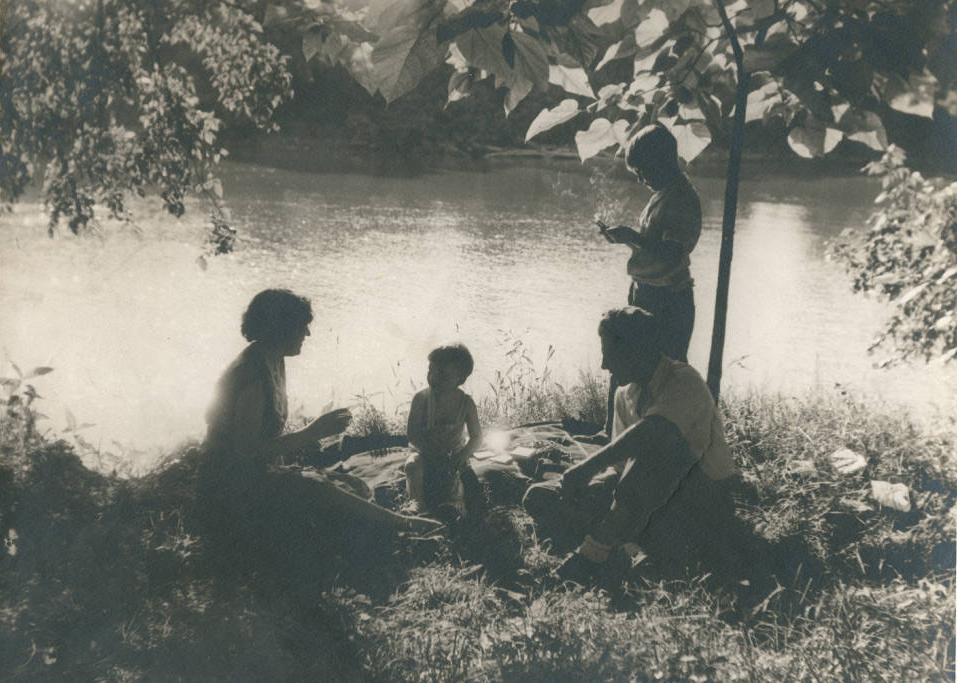 A family enjoying a picnic along the Tuscarawas River, from the Ohio Guide Collection via Ohio Memory.