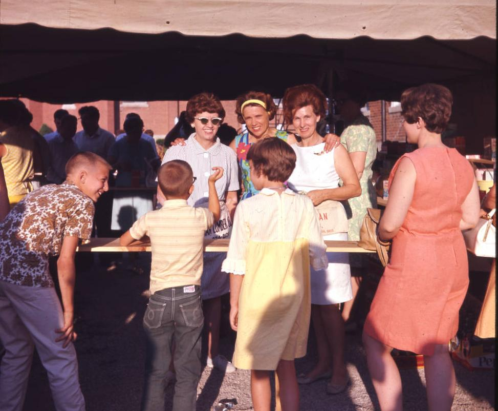 Picnic attendees celebrating at the St. Henry Community Picnic, ca. 1966. This longtime tradition happens over the July 4th weekend in the village of St. Henry. Via Ohio Memory.