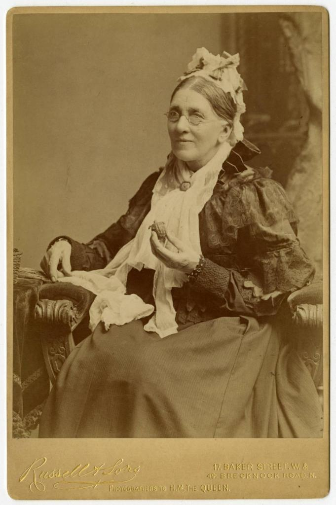 Portrait of Hopley later in life, holding a small turtle, via Ohio Memory.