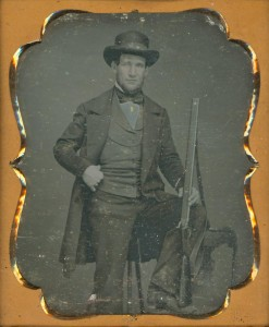 Daguerreotype portrait of an unidentified man with gun, 1848. Via Ohio Memory.
