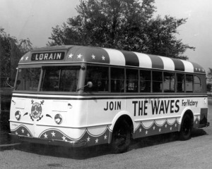 "Bus proclaiming, ""Join the WAVES for Victory,"" owned by the Lorain Employees Transit Company and serving the cities of Lorain, Elyria, Amherst, and Oberlin. Courtesy of the Lorain Public Library System via Ohio Memory."