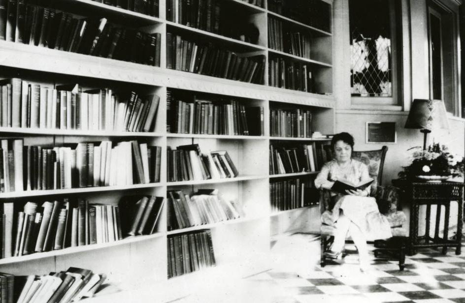 Martha Kinney Cooper reading a book in the Governor's Residence, ca. 1930. Via Ohio Memory.