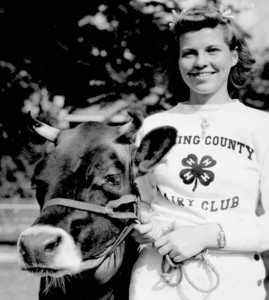 We bet this member of the Licking County Dairy Club, pictured with her cow at the Ohio State Fair in 1939, would vote for the founding of 4H!