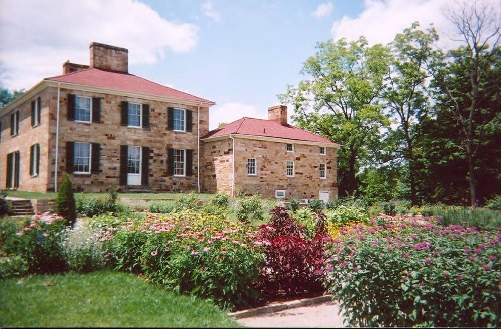 Exterior view of the Adena Mansion and flower garden, via Ohio Memory.
