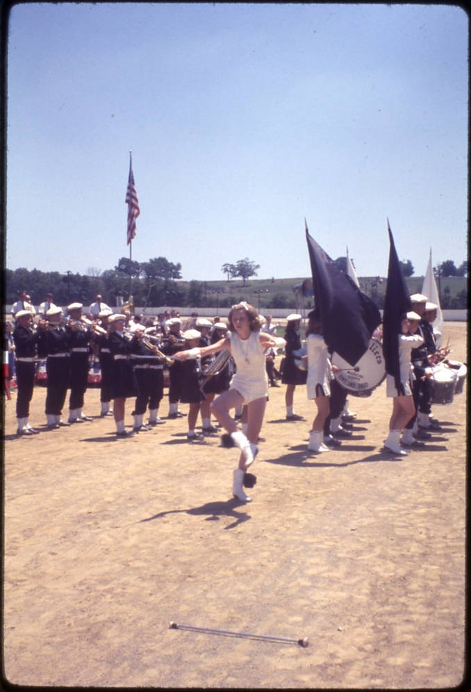 Fourth of July festivities in Hamilton, Ohio, 1968, including a marching band, flag corps and baton twirler. Via Ohio Memory.