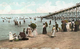 1910 postcard showing adults and children enjoying the beach at Cedar Point, via Ohio Memory.