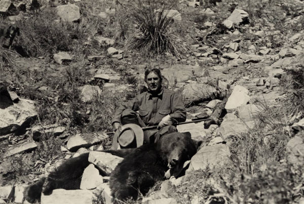 Photograph of Grey during a hunting trip, with a large bear shot in the Hells Gate area of Tonto Basin, Arizona, ca. 1919. Via Ohio Memory.