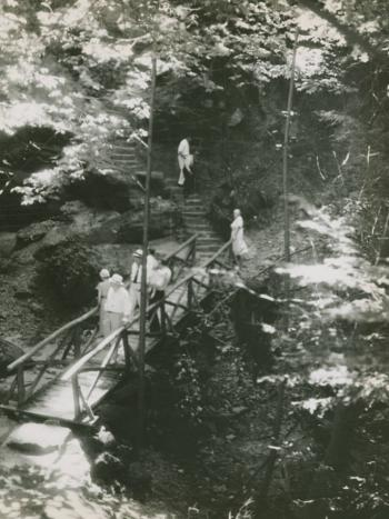 Hikers on a Hocking Hills trail, likely constructed by the Civilian Conservation Corps, a public work relief program as part of President Franklin Roosevelt's New Deal. Via the Ohio Guide Collection on Ohio Memory.