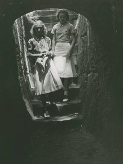 Two young women descend a rock-cut staircase at Old Man's Gorge, via the Ohio Guide Collection.