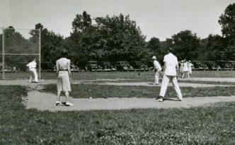 Men and women playing baseball, ca. 1940, via the Ohio Guide Collection on Ohio Memory.