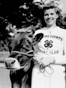 Licking County Dairy Club member with her cow at the Ohio State Fair, 1939. Via Ohio Memory.