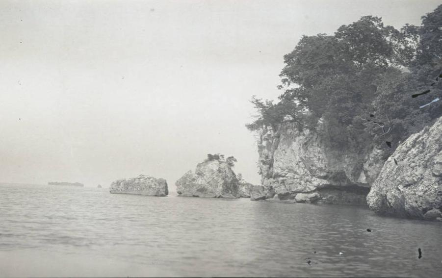 Rocky shore of Gibraltar Island, which was used by Perry and his naval forces as an observation site during the battle. Via Ohio Memory.