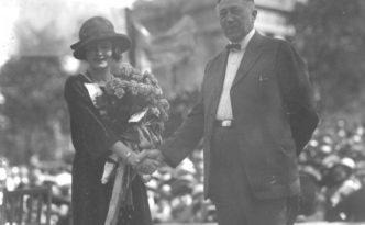 Mary Katherine Campbell of Columbus, Miss America in 1922 and 1923, shaking hands with Columbus Mayor James J. Thomas. Via Ohio Memory.