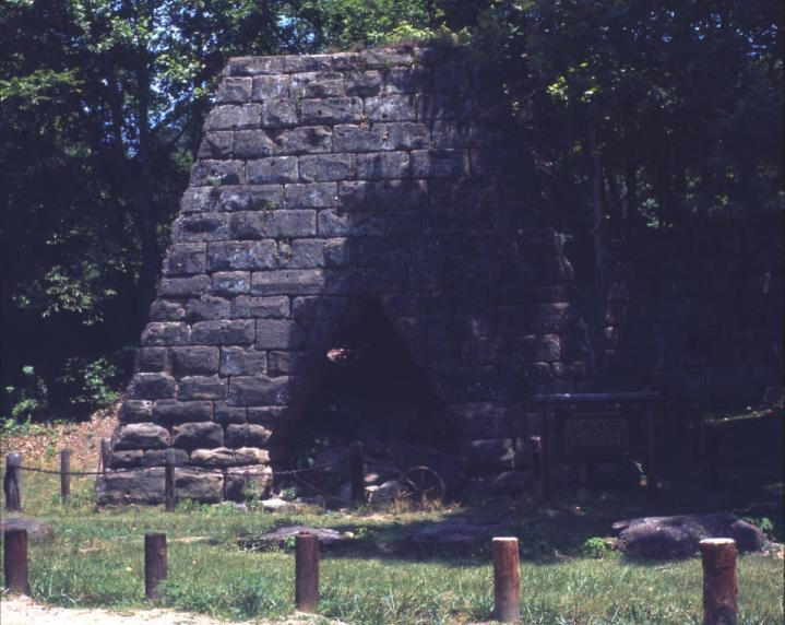 "Vesuvius Iron Furnace near Ironton, Ohio were taken around 1965. Named after the Mt. Vesuvius volcano in Italy, the furnace was built in 1833 to supply iron to steel manufacturers in northern Ohio, Pennsylvania, and other parts of the nation. It produced 3,000 tons of pig iron, made from iron ore and limestone, per year. The supply of iron ore diminished by the end of the nineteenth century and the furnace was abandoned. The furnace was one 46 charcoal iron furnaces located in the Hanging Rock Iron Region of southern Ohio. Vesuvius Iron Furnace is located north of Ironton, Ohio in the Wayne National Forest. It is listed on the National Register of Historic Places. The slides measure 2.75"" x 2.75"" (6.99 x 6.99 cm)."